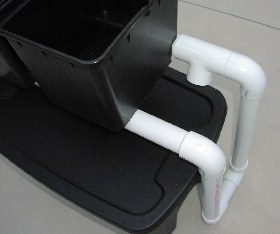 buckets sit on PVC drain pipe