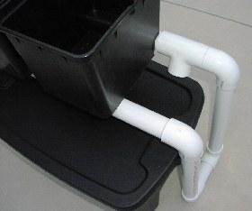 buckets sit on PVC drain pipe