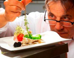 chef using fresh herbs