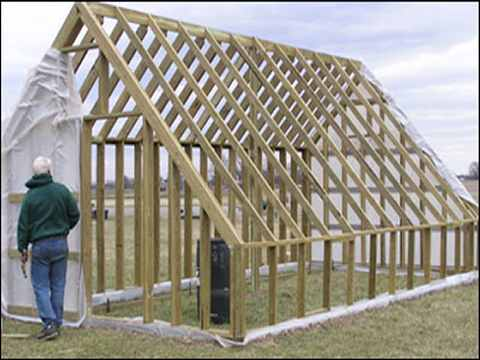 wooden A-frame greenhouse