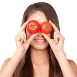 girl holding hydroponic tomatoes